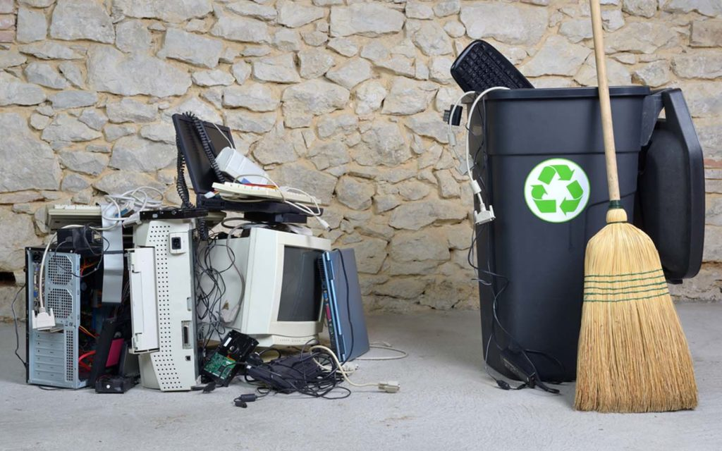 electronic waste, e-bin and a broom