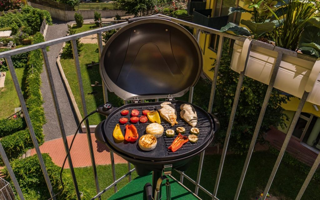 A small grill set in an apartment terrace