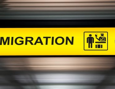 Direction to immigration counter, where overstay fines in the UAE are enforced