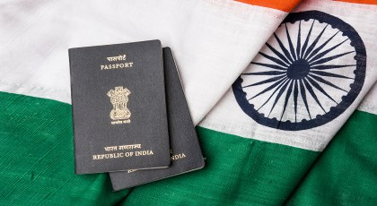 Indian passports with Indian flag in the background