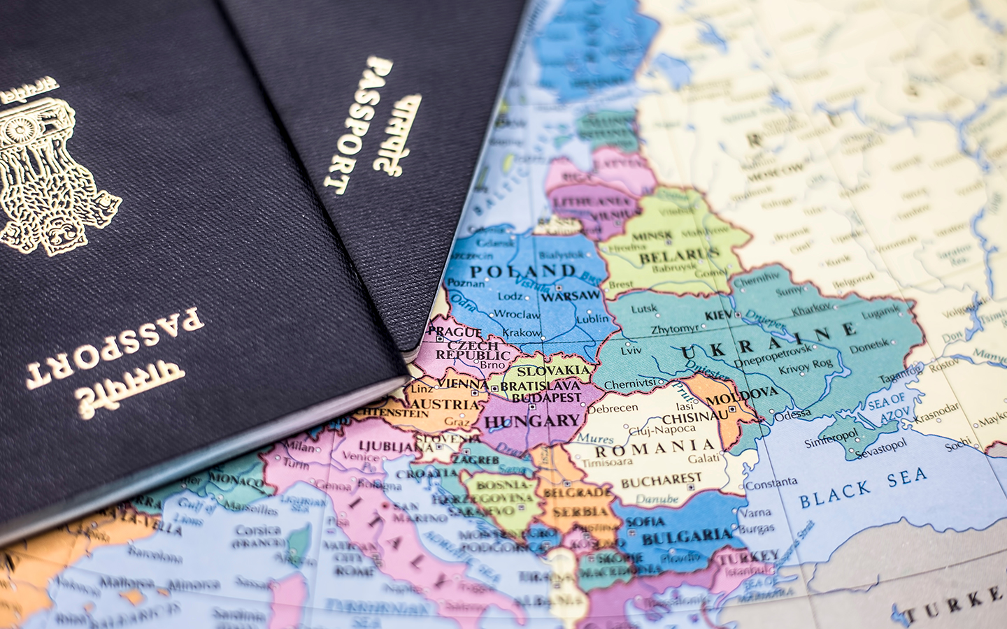 Indian passports on a map of the world