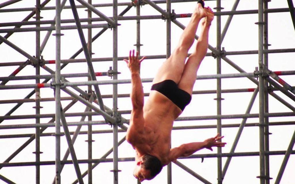 Man jumping off a platform at The Arch Dubai