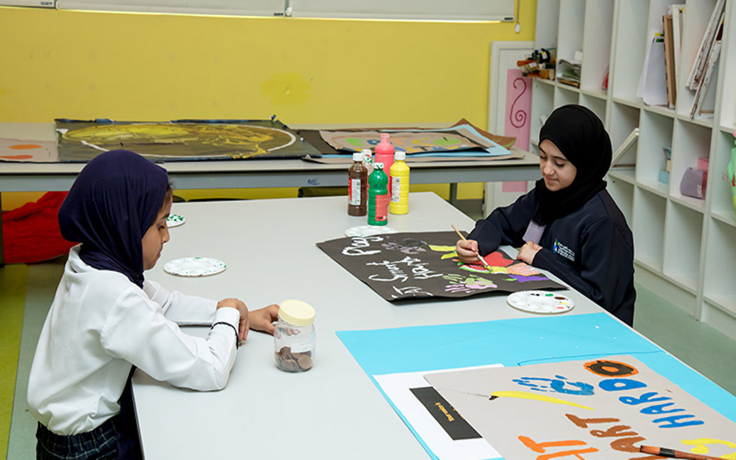 two school children working on a project