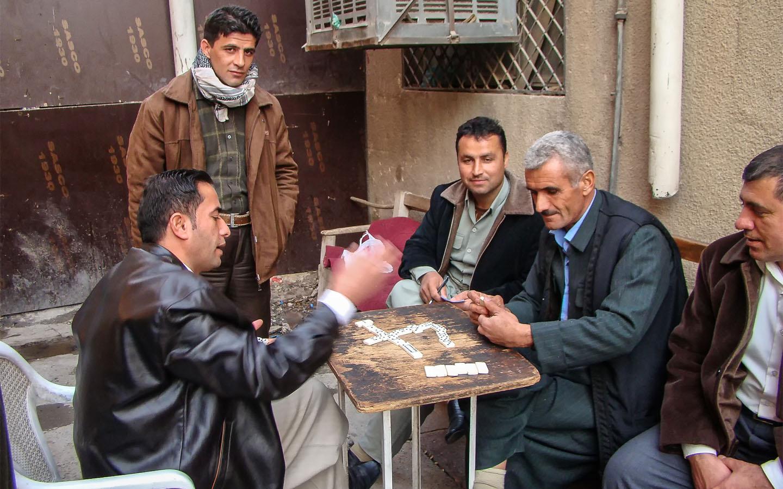 Iraqi men playing games in a bazar