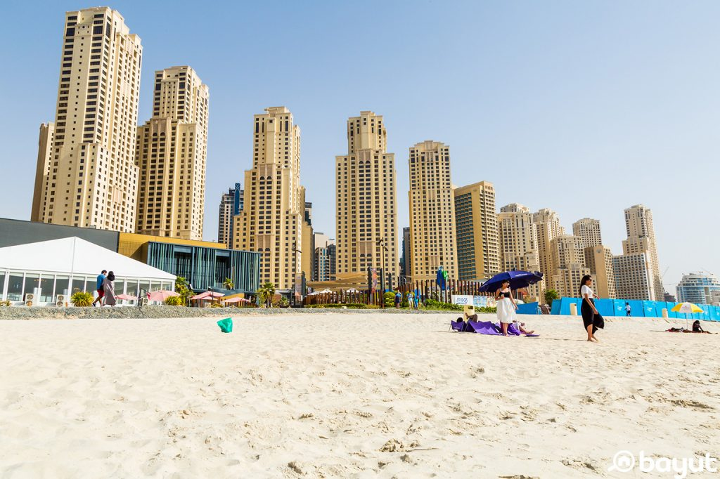 The empty beach at JBR Dubai with the JBR buildings in the background