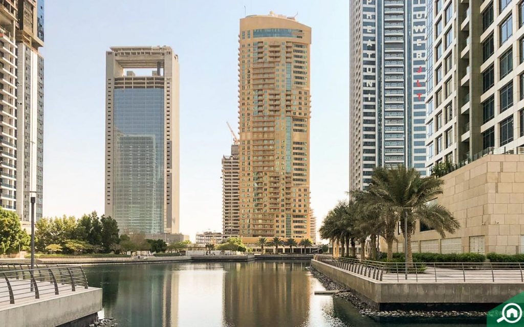 View of Icon Tower and other buildings around the JLT lake