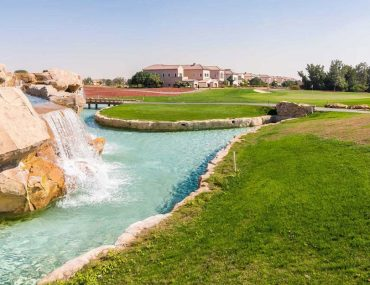View of golf course, water feature and villas in Jumeirah Golf Estate