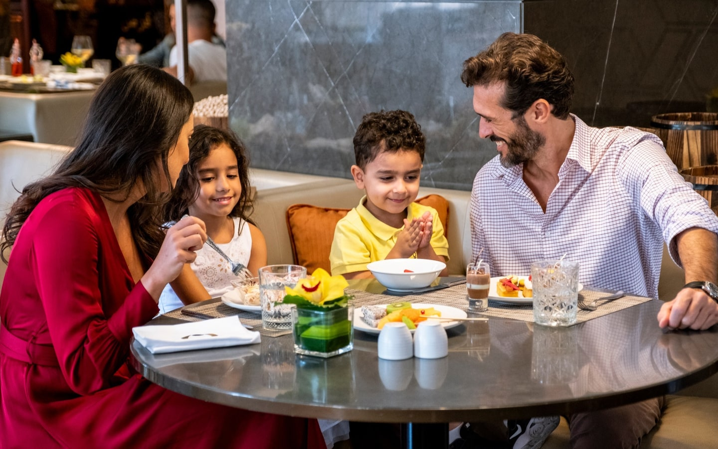 Parents and two kids and Olea restaurant, part of a Dubai NYE Hotel deal