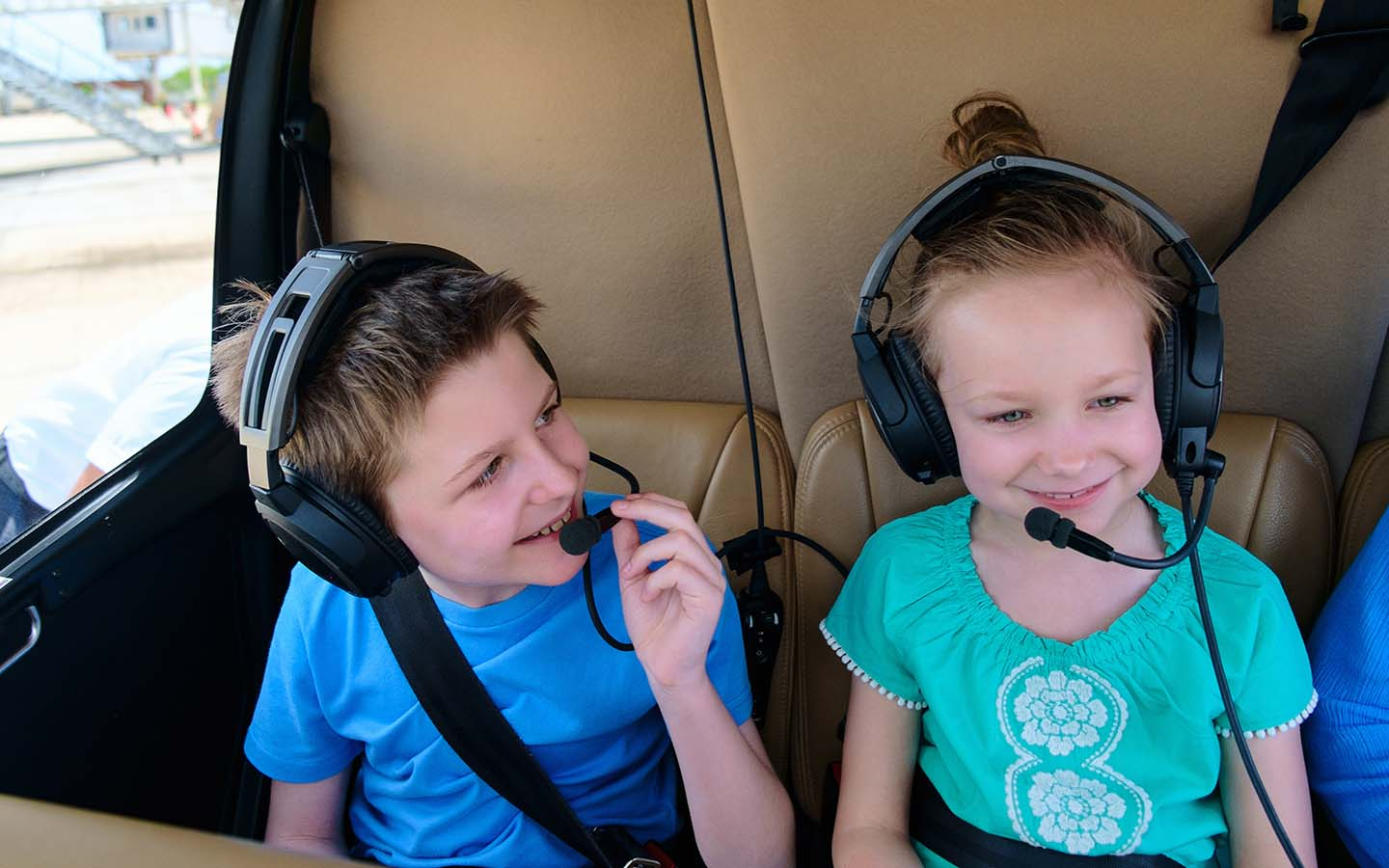 Kids sitting in a helicopter