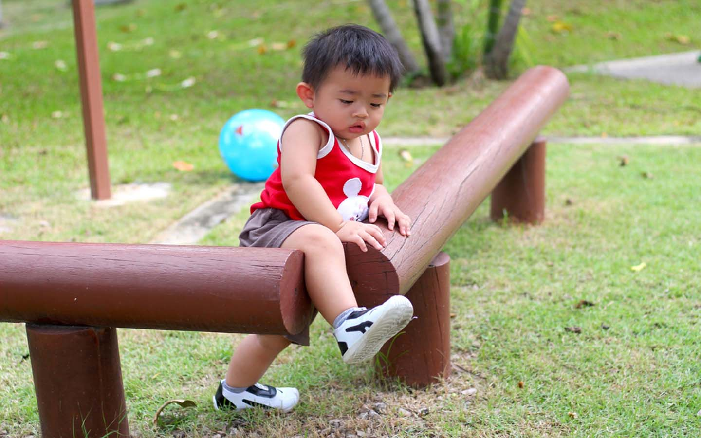 A boy playing in a park's kid area
