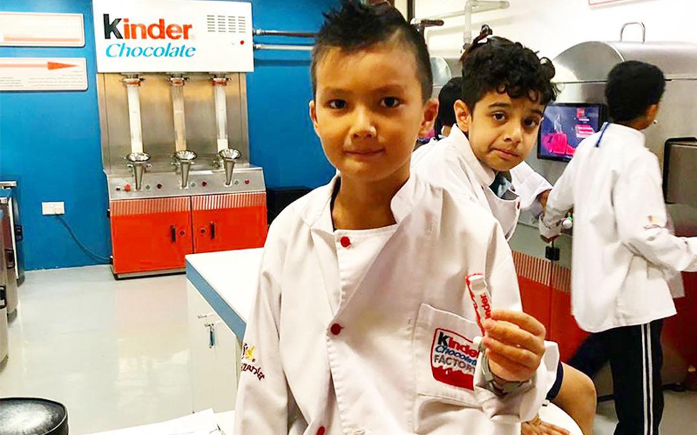 Kid making chocolate cookies at KidZania Kinder Factory