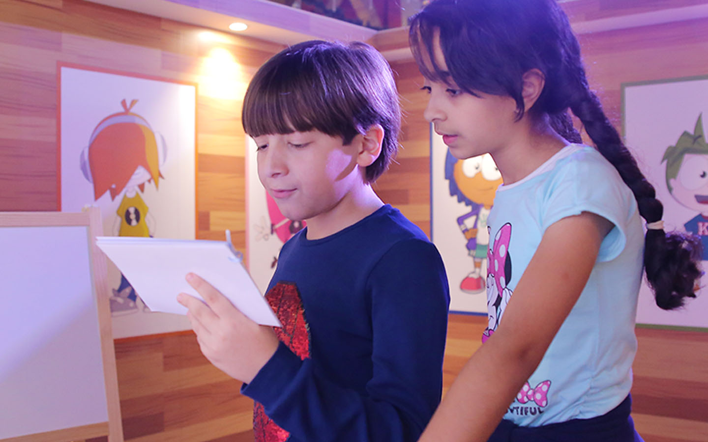 Children discussing about activities in KidZania