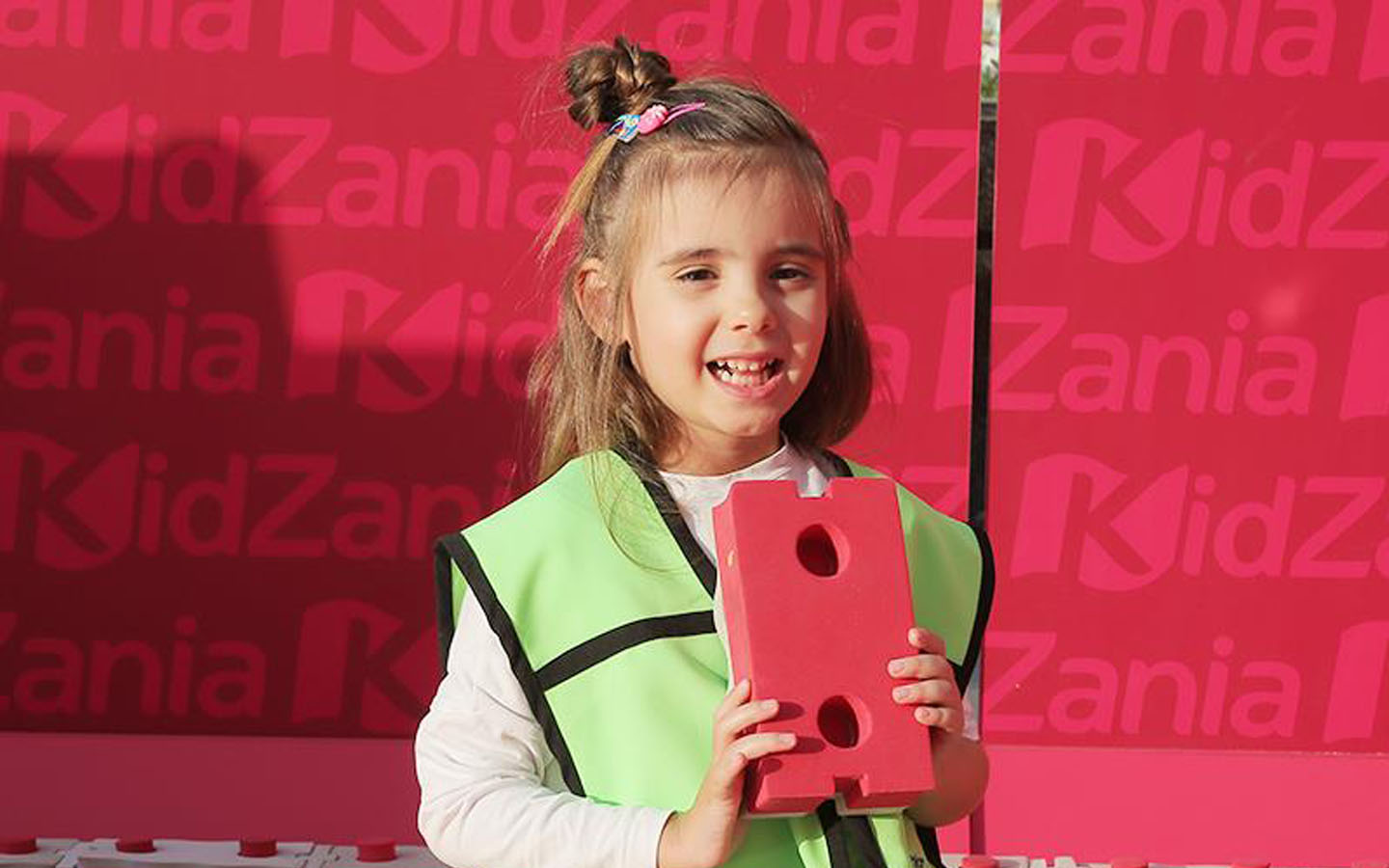 Close-up shot of a happy girl at KidZania