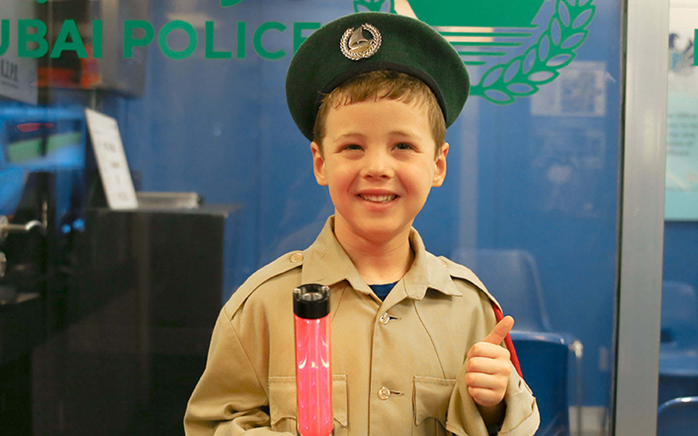 Close-up shot of a kid working as a police officer at KidZania