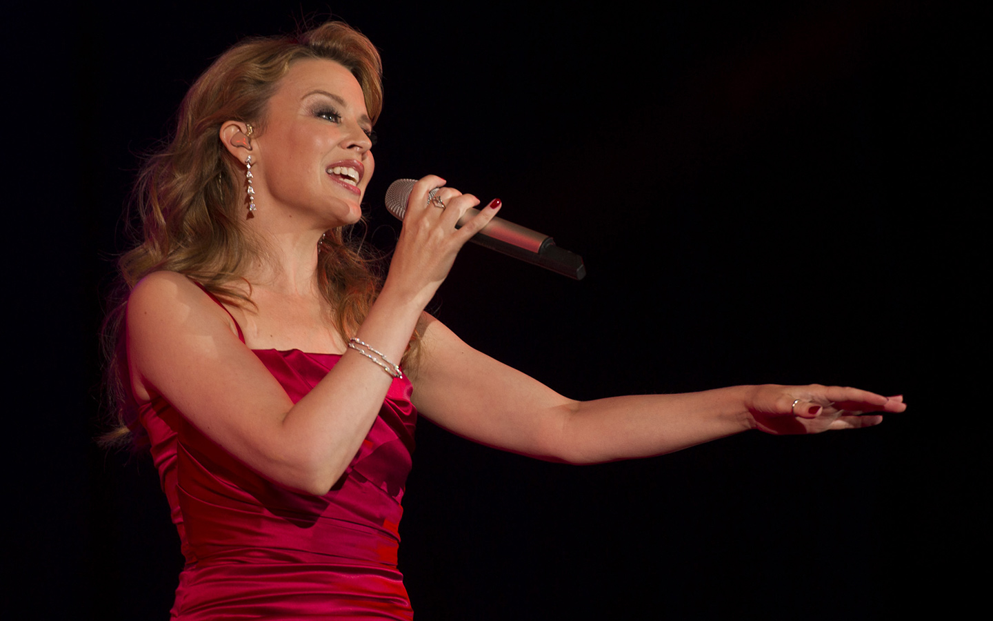 Kylie Minogue singing at a concert