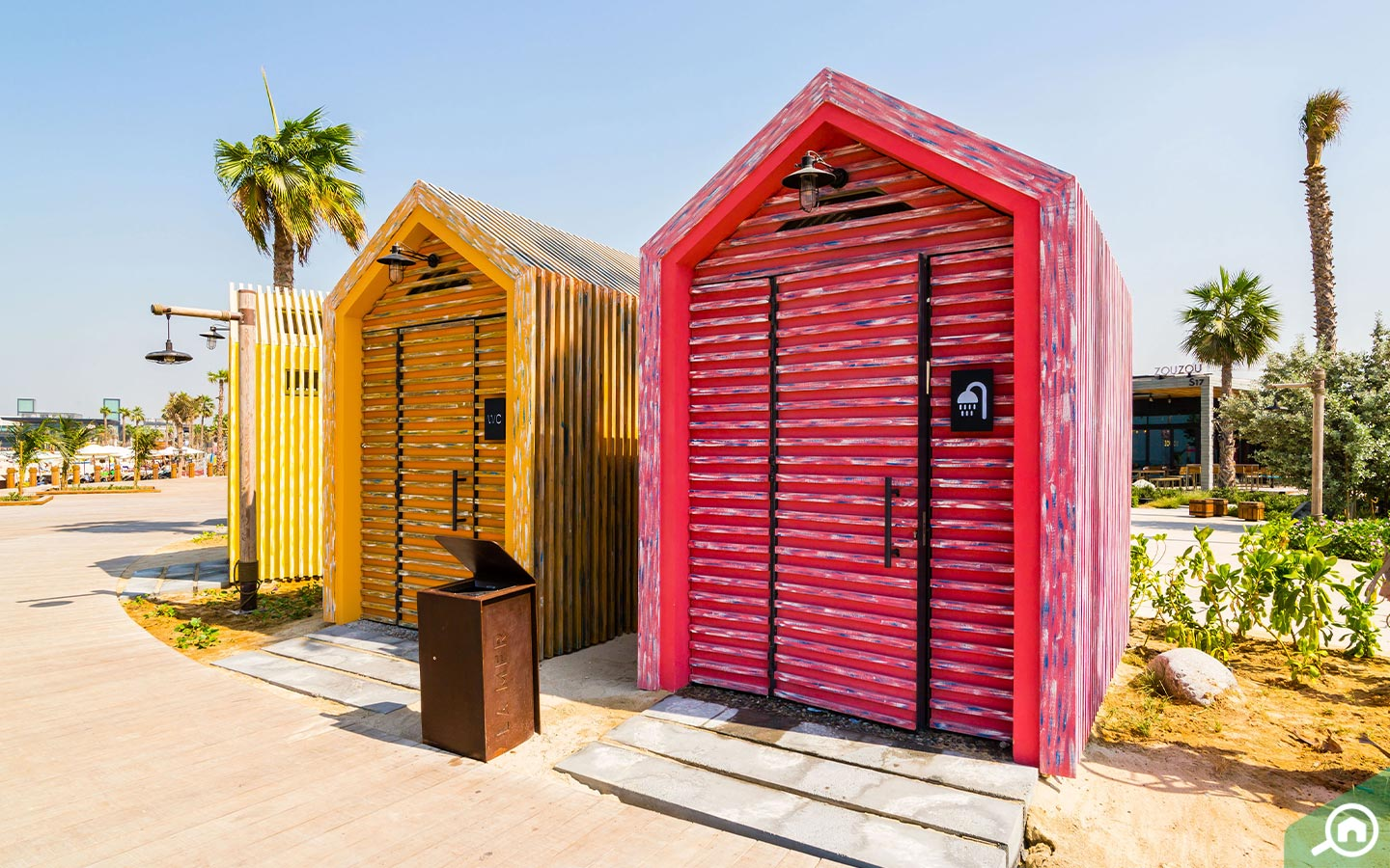 Two colourful and quirky indoor showers at La Mer Beach