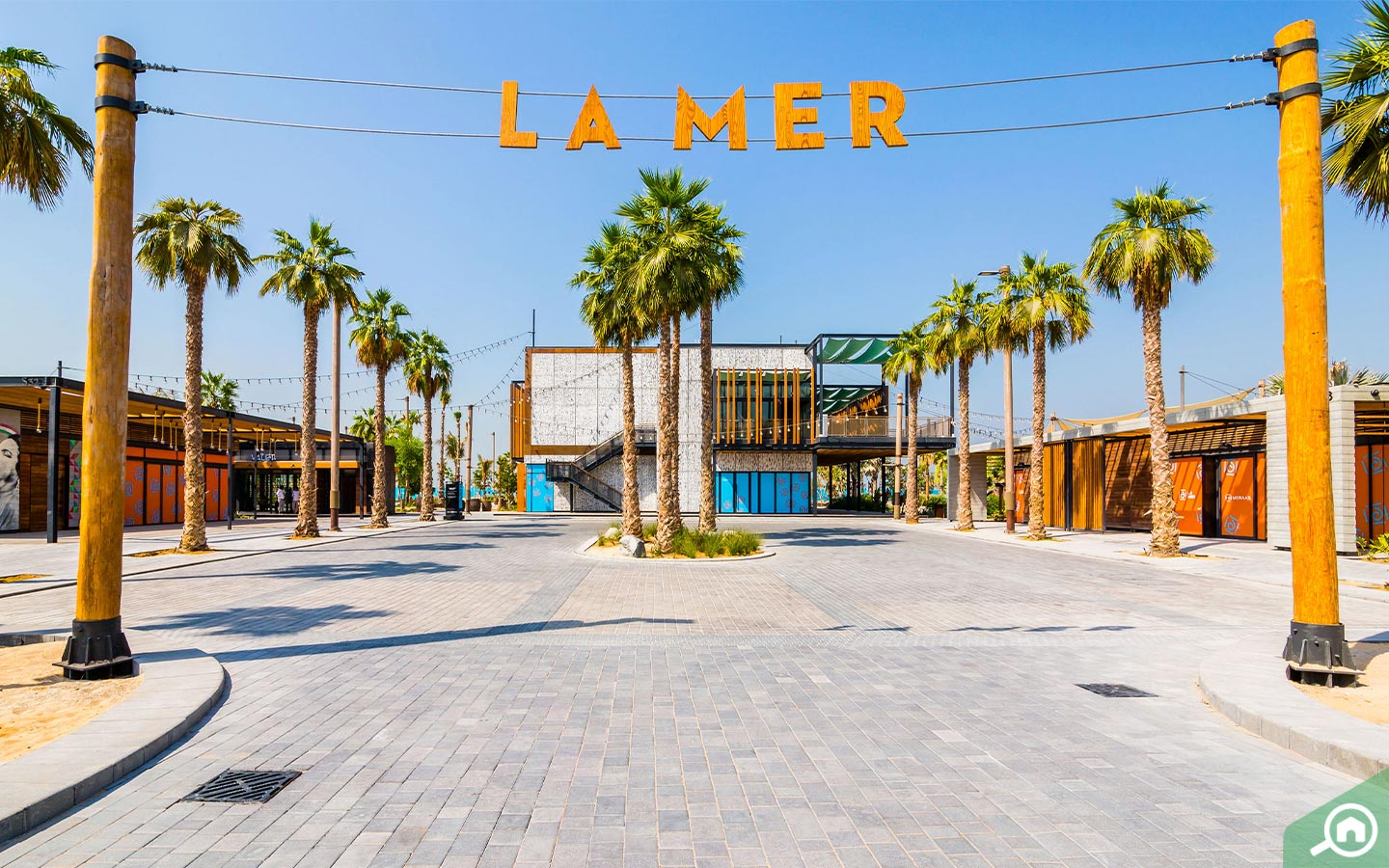 The entrance to La Mer Dubai at Jumeirah 1 with an orange La Mer sign