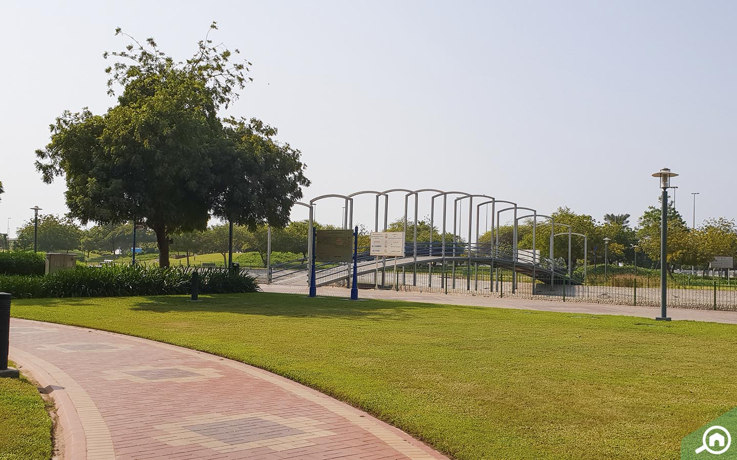 Wooden bridge in Lake Park, one of the parks in Abu Dhabi