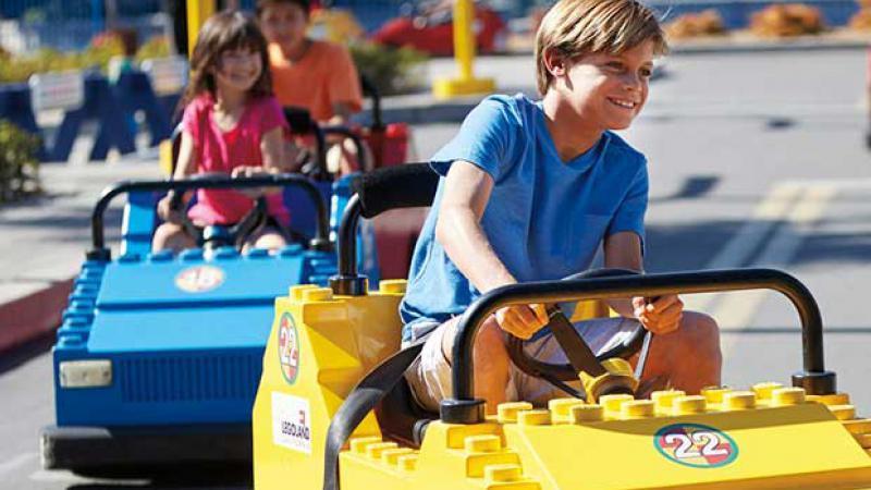 Children driving Lego-based cars at Legoland Dubai