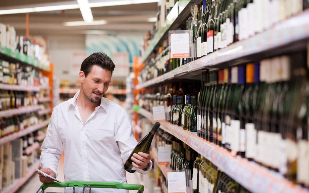 Man shopping for alcohol in Dubai