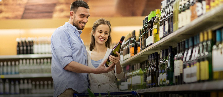 Man and Woman buying liquor in Dubai
