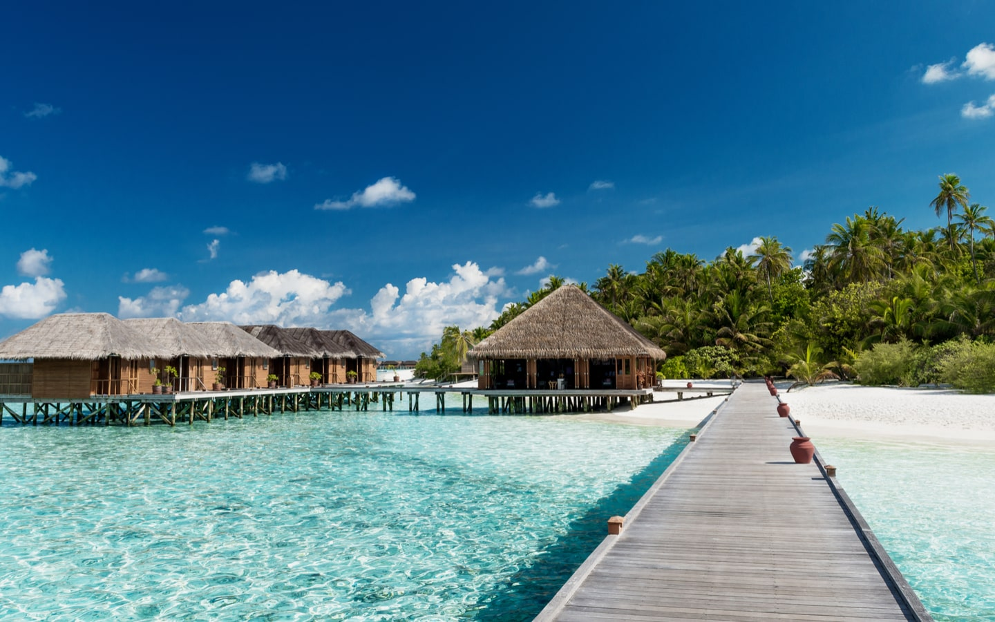 View of overwater villas and beach in Maldives