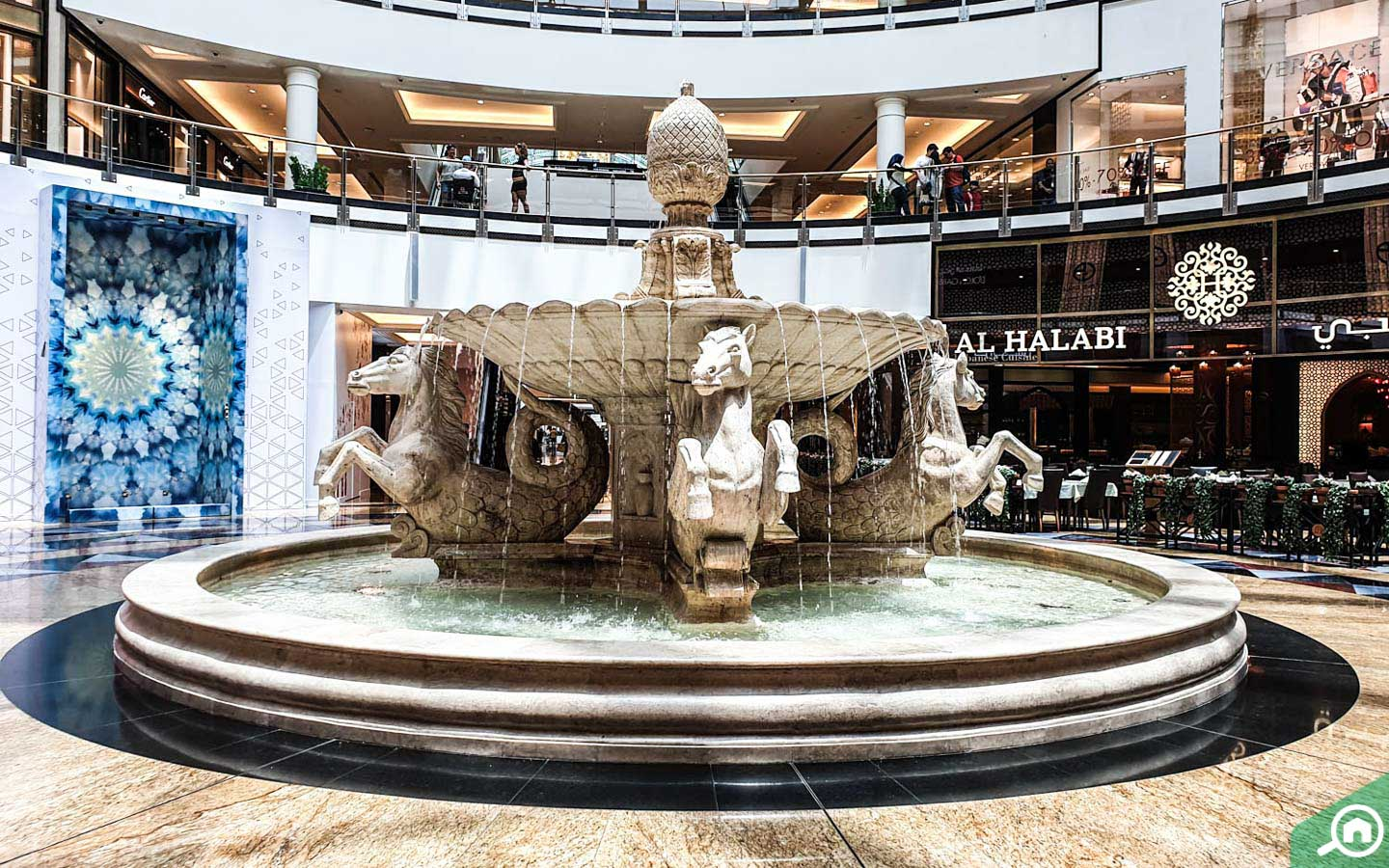 Inside of view of fountain and shops in the mall of the Emirates