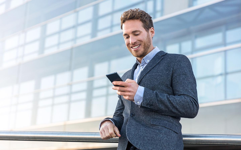 Man completing renewal of car registration in Dubai through mobile app
