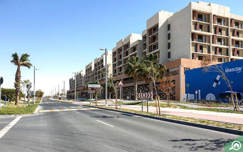View of apartment buildings and street in Masdar City