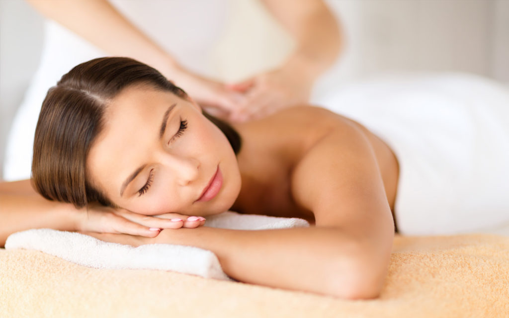 A lady in a massage session