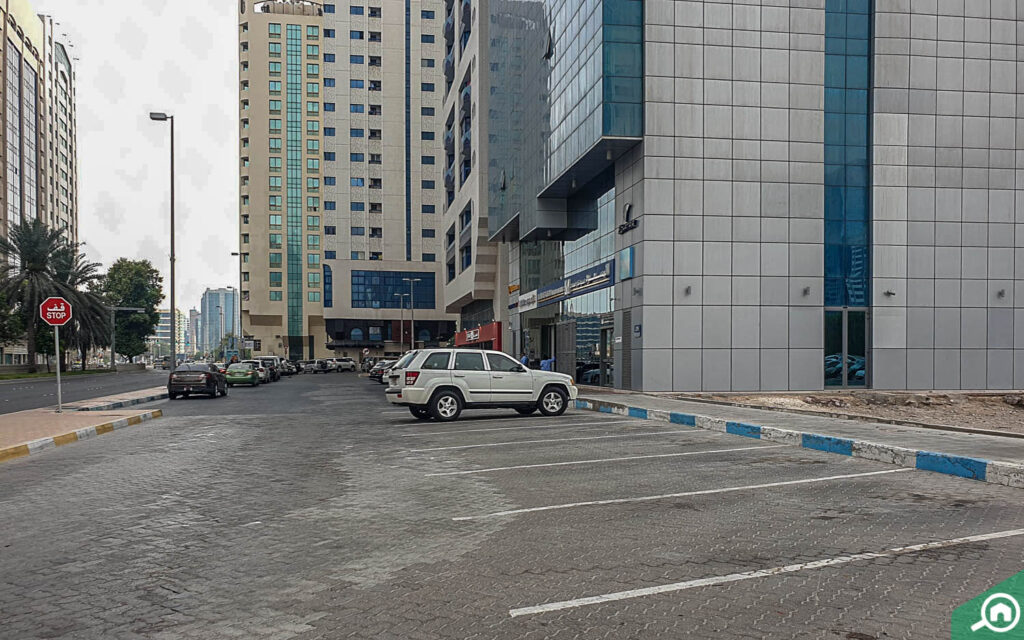 parking adjacent to a building in Abu Dhabi
