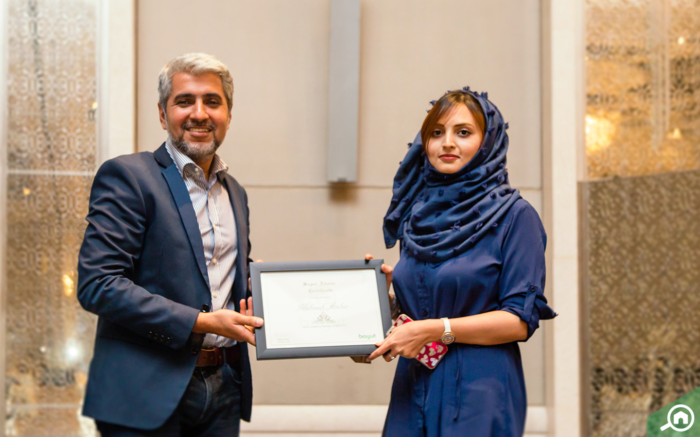 Super Admin Mehwish Ambar receives certificate from Bayut's CEO Haider Ali Khan