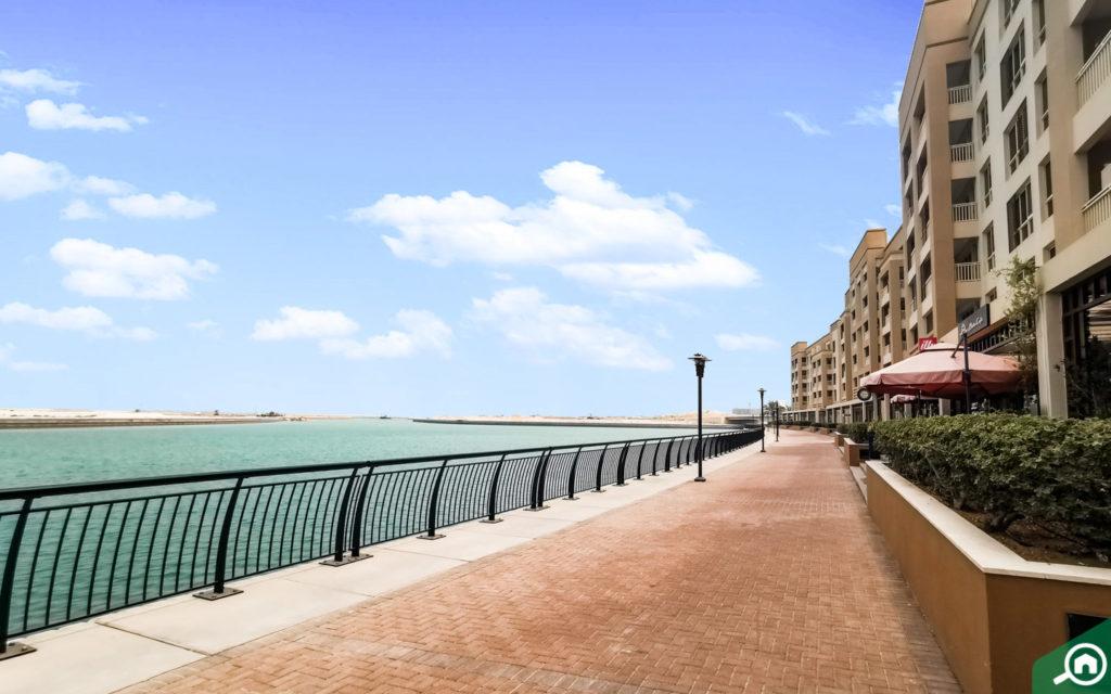 View of promenade and buildings at Mina Al Arab, which has rental apartments in RAK