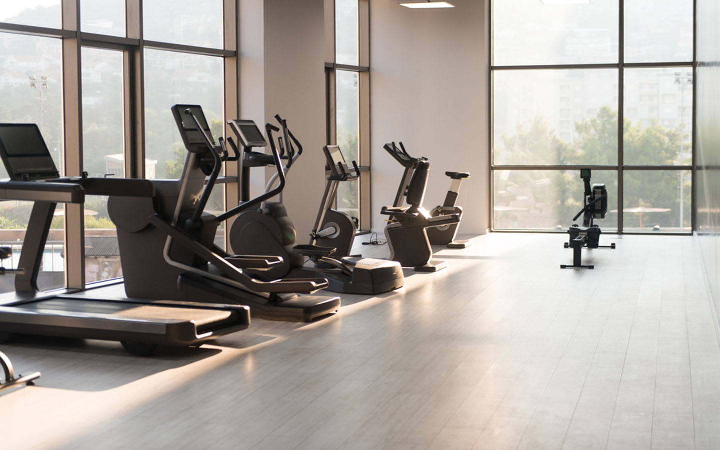Inside of a gym with treadmills