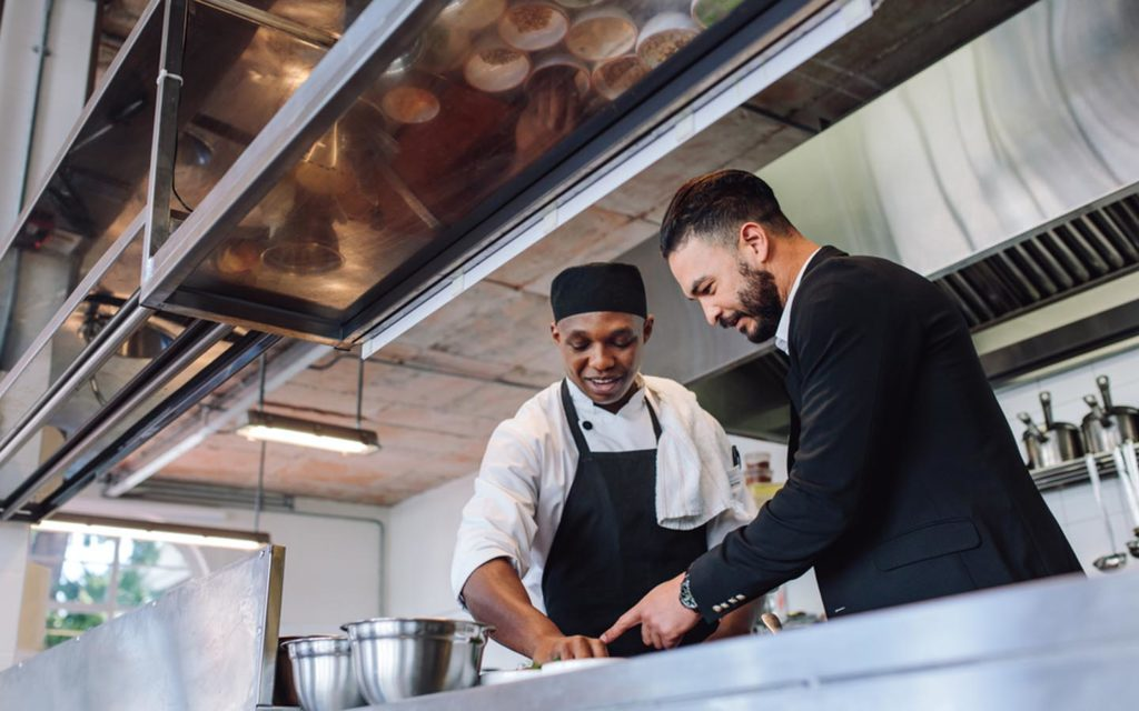 a restauranteur with chef at a Dubai restaurant