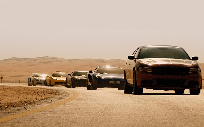 Sports car from Furious 7 driving through a desert in Dubai