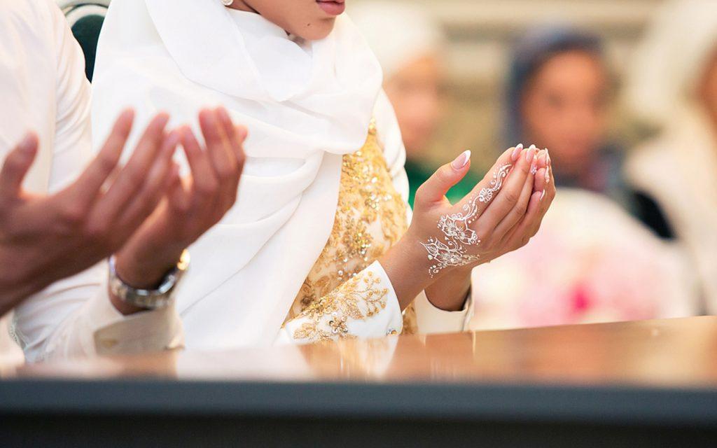 Muslim couple praying on their wedding