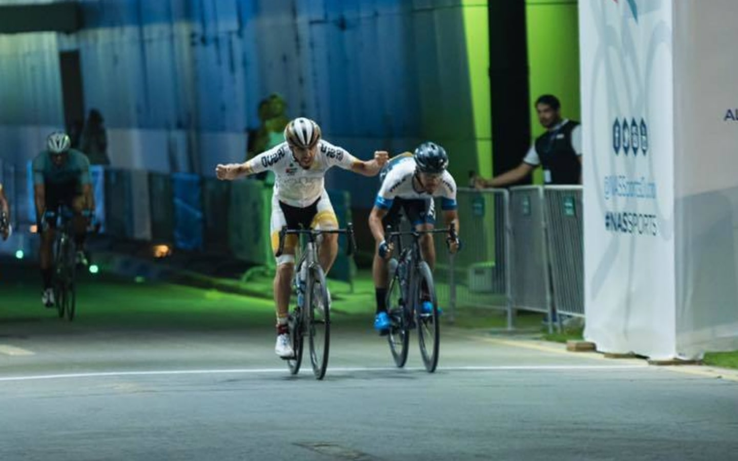 Cyclists at NAS Sports Tournament crossing the finish line