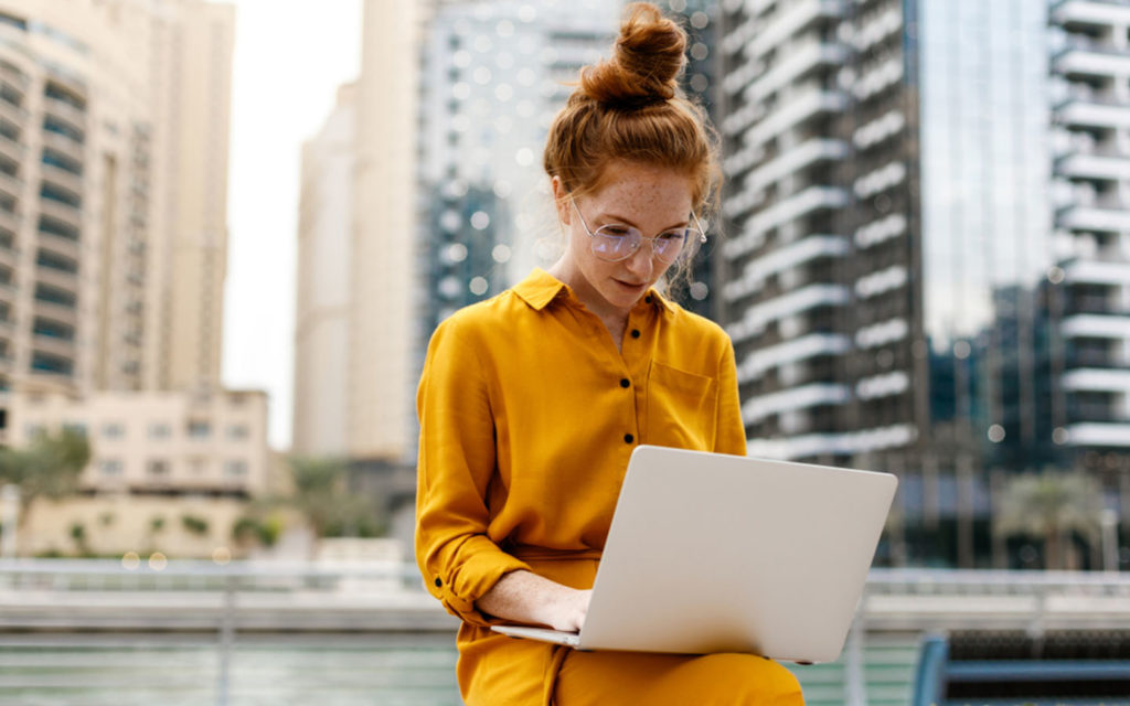 young woman with laptop in Dubai