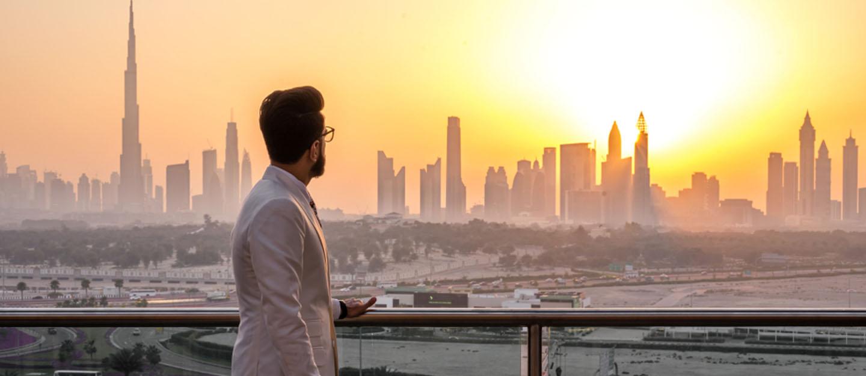 expat man with Dubai skyline