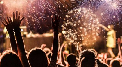 people cheering New Year fireworks