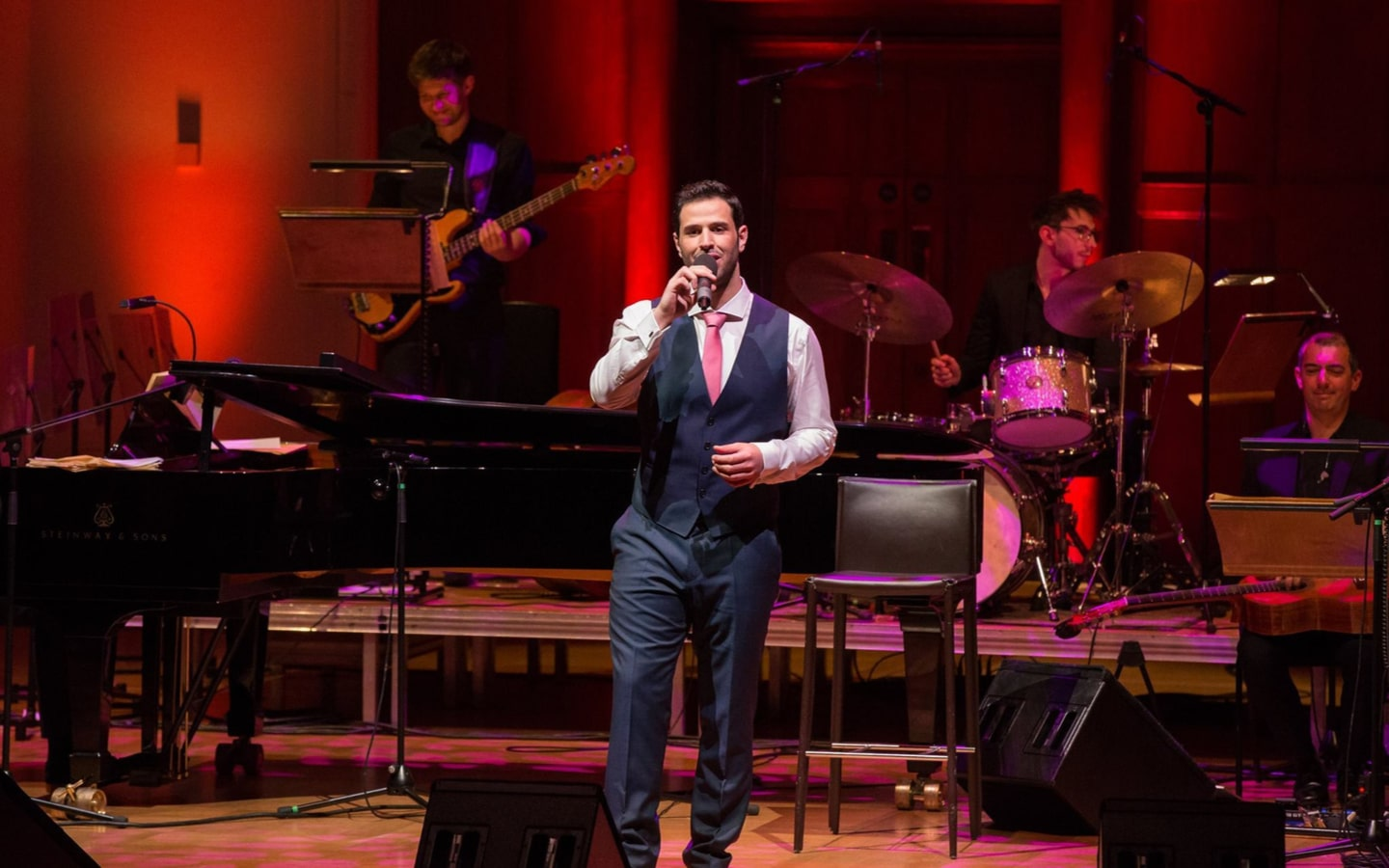 Omar Kamal singing on stage with musicians in background, performer at the upcoming shows at Dubai Opera