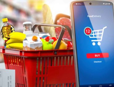Shopping bucket with a mobile phone for online grocery delivery in Ras Al Khaimah