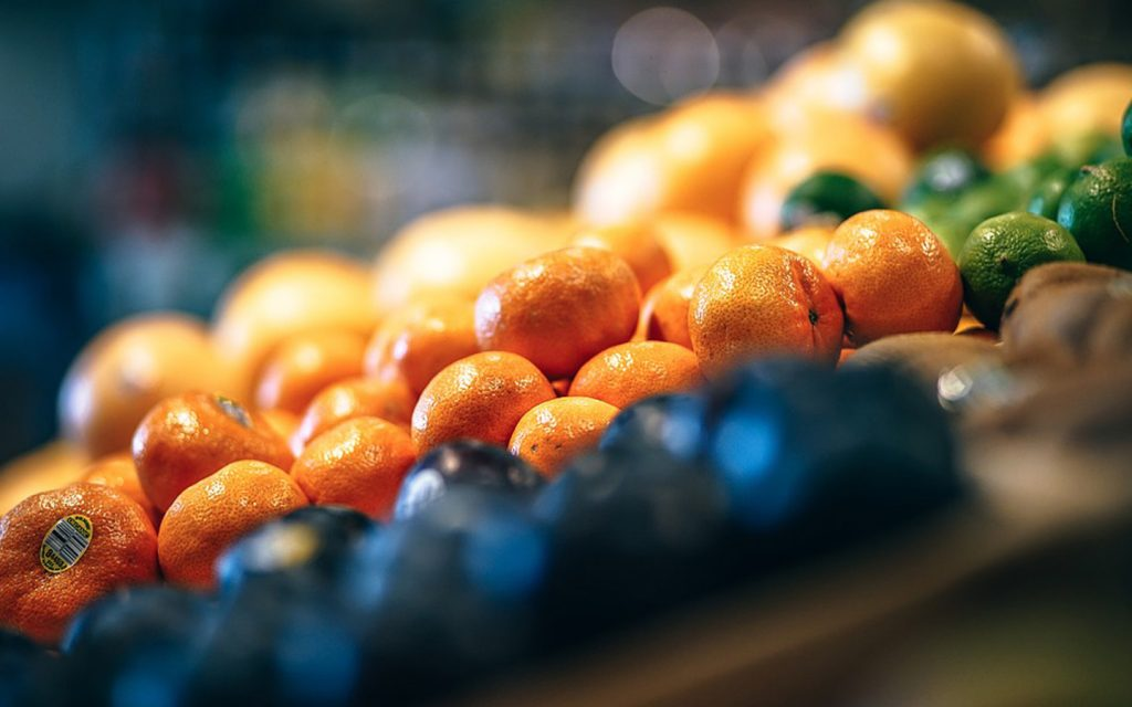 Fruits displayed at the supermarket, which residents can order through online grocery in Sharjah