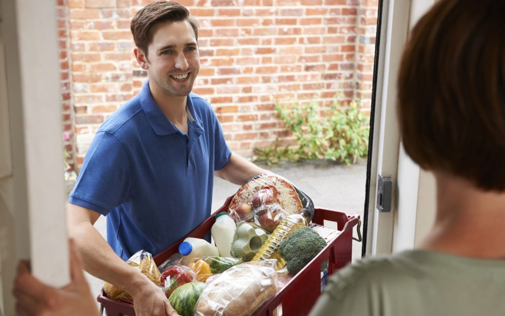 man delivering grocery at home