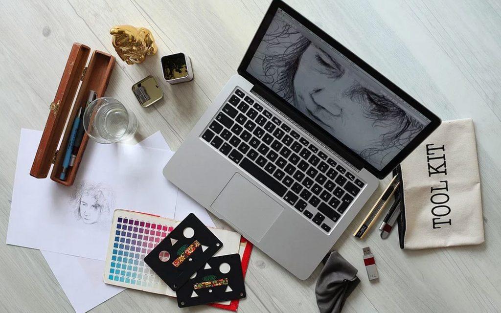 Laptop and colour palette for graphic designer online course in Dubai during quarantine