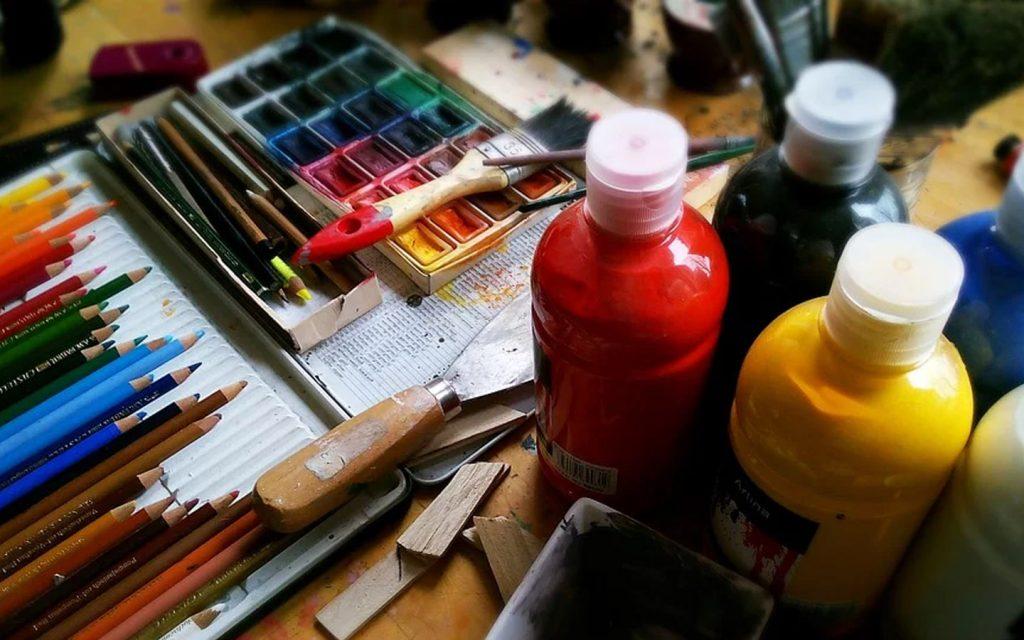 Paint bottles and colour pencils and colour palettes