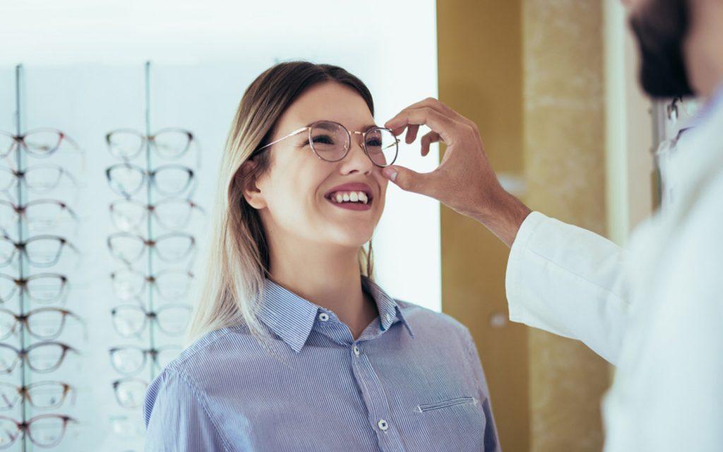 girl selecting a frame for prescription glasses