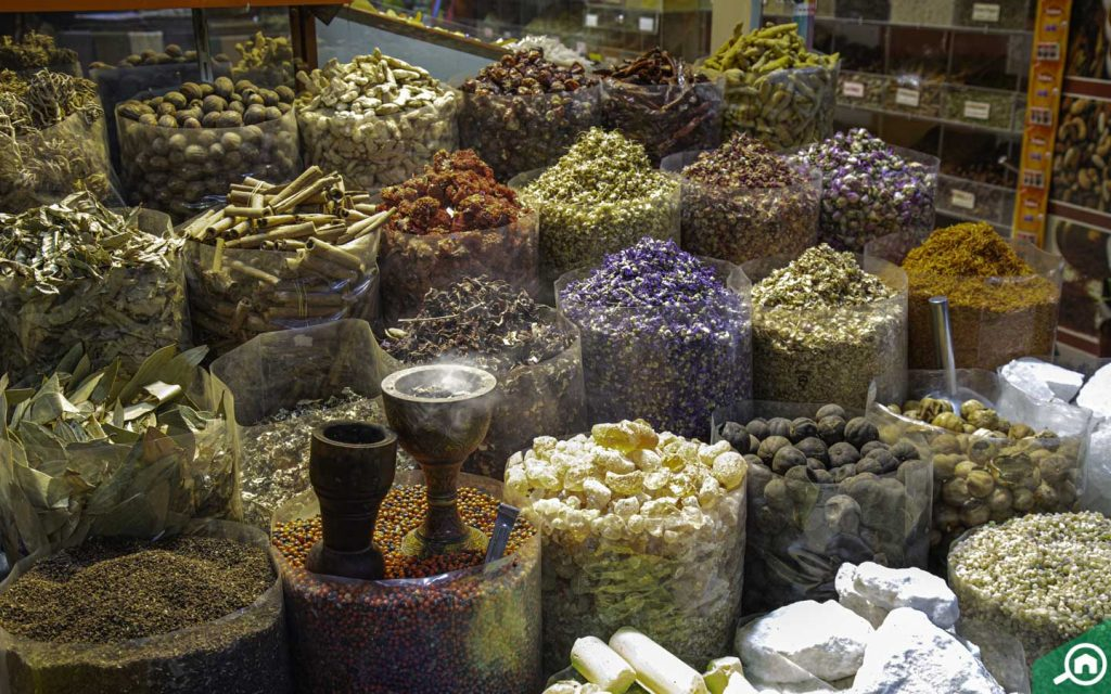 Oud and spices lined up at a souk in Dubai