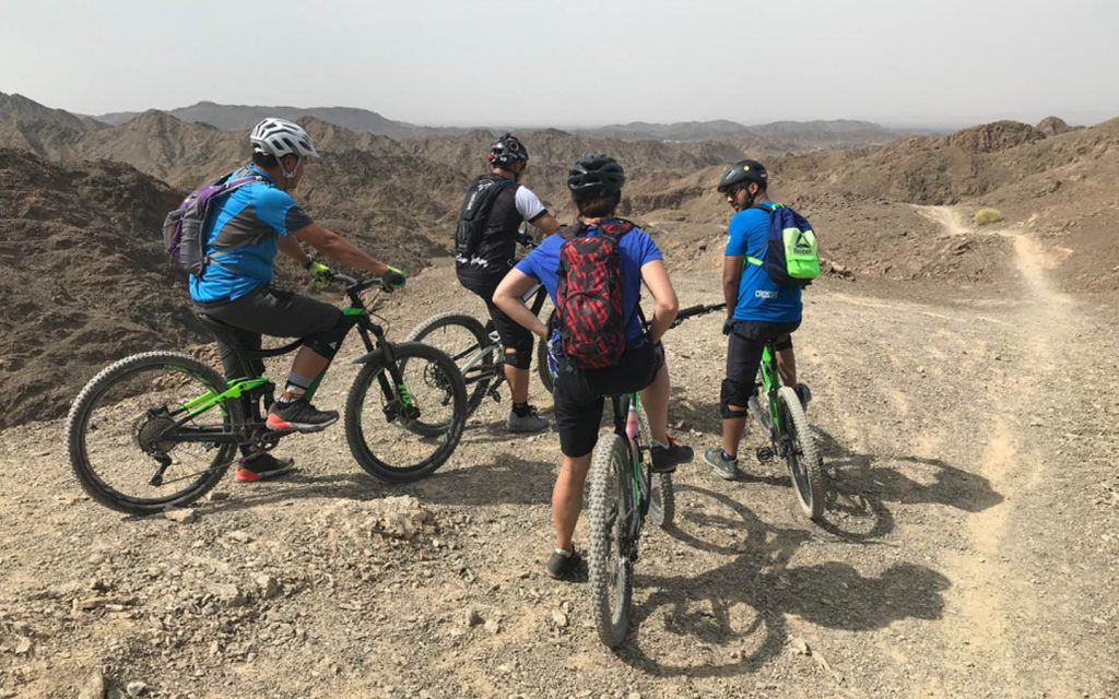 Group of mountain bikers offroading  for an outdoor adventure in the UAE